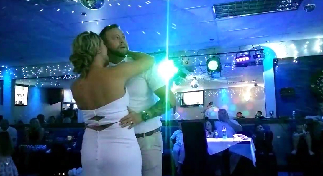 New groom is tempted to watch the rugby during his first dance