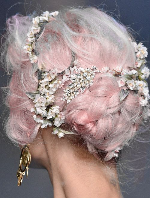 A Rose Quartz braided hairstyle adorned with little flowers would be a lovely bridesmaid or bridal hairstyle. Image: Dolce & Gabbanna