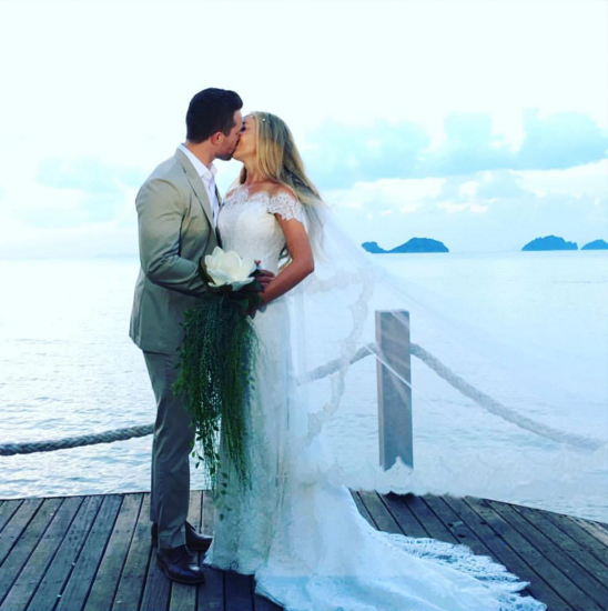 Jessica and Dean share a kiss on their wedding day. Image: Jessica Sepel via Instagram